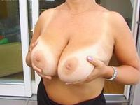 Mature hoe with massive tits getting naked