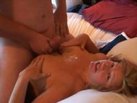 Big breasted blonde titty-fucking on cam