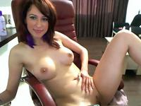 A dark haired babe with nice tits getting off