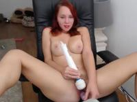 A red haired slut uses toys on both of her holes