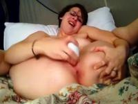 Young woman is using a dildo