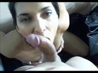 Sexy woman is giving a blow job