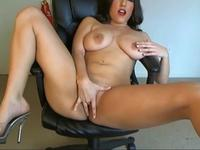 Busty chick sits on a dildo