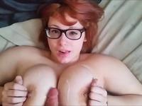 A redhead is cumshot on her tits