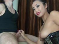 Asian babe is rubbing a cock