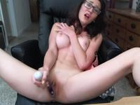 A hot bimbo is massaging her pussy