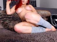 Girl with big boobs and red hair plays with animals and her pussy