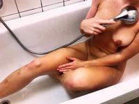 Babe masturbates in the bath
