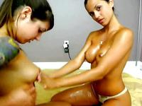 Oiled Misty and Janessa having fun