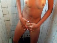 Nude darling taking a shower