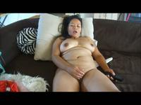 Chubby Asian milf plays with her cooch