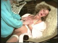 Mature blonde treating her slit